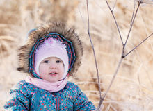 baby girl on snow Royalty Free Stock Photos