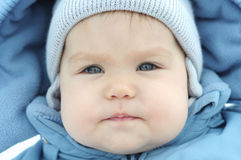 Baby girl in snow suit Stock Images