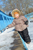 Baby girl in snowsuit on the snow Royalty Free Stock Images