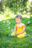 Baby girl with soap bubbles Stock Photos