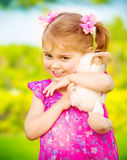 Baby girl with soft toy. Closeup portrait of cute baby girl hugging soft toy outdoors, having fun on backyard in daycare, spring season, happiness concept royalty free stock photos