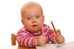 Baby girl with some pens Stock Images