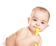 Baby girl with spoon Stock Photography