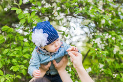 Baby girl in spring blossoming garden Royalty Free Stock Images