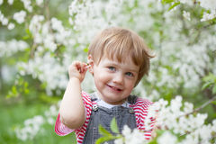 Baby girl in spring  garden Stock Photo