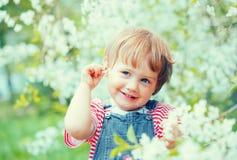 Baby girl in spring  garden Royalty Free Stock Photo