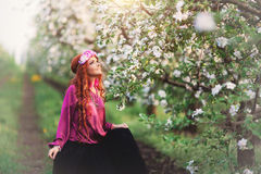 Baby girl spring gardens and woman, dandelions Stock Photos