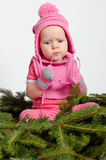 Baby Girl on Spruce Needles Royalty Free Stock Images