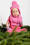 Baby Girl on Spruce Needles Royalty Free Stock Photos