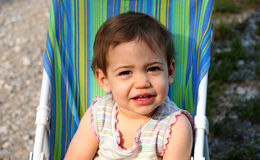 Baby Girl Squinting. Beautiful baby girl in push chair squinting. Shot with a Canon 20D stock photography