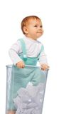 Baby girl stand in the basket bin Royalty Free Stock Image