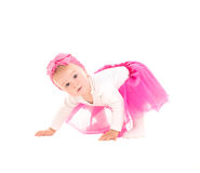 Baby girl standing on all fours in pink tutu Stock Photography