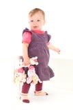 Baby girl standing on crib Stock Photo