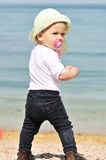 Baby girl standing near the sea Stock Image