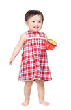 Baby Girl standing with snack box Royalty Free Stock Photography