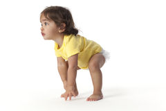 Baby girl in a start position off to run Royalty Free Stock Photo