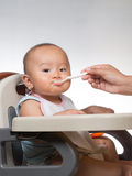 Baby starting on solids 4 Stock Image