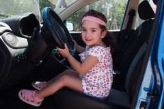 Baby girl at steering wheel Royalty Free Stock Image