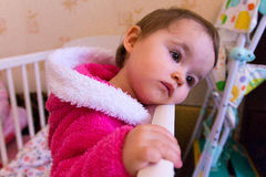 Sad Baby girl stood in her cot Royalty Free Stock Photo