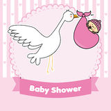Baby girl and stork Stock Photos