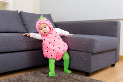 Baby girl with strawberry costume Royalty Free Stock Image