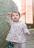 Baby girl in the street pointing up Royalty Free Stock Photography