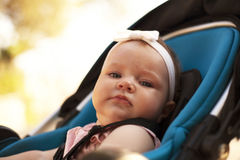 Baby girl in a stroller Royalty Free Stock Photo