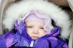 Baby girl in stroller outdoors Royalty Free Stock Photo