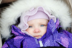 Baby girl in stroller outdoors Royalty Free Stock Images