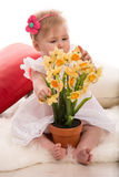 Baby girl studi daffodils flowers Royalty Free Stock Photos