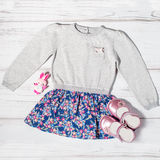 Baby girl stylish casual clothes collection on a wooden background Royalty Free Stock Image