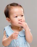 Baby girl suck finger Stock Photo