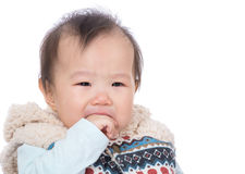 Baby girl suck finger into mouth Royalty Free Stock Photos