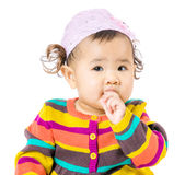 Baby girl suck finger into mouth Royalty Free Stock Images