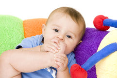 Baby Girl Sucking on Foot Stock Image