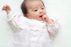 Baby girl sucking her fingers Stock Image