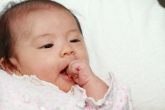 Baby girl sucking her fingers Stock Photos