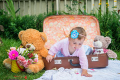 Baby girl in suitcase Stock Images