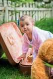 Baby girl in suitcase Stock Image