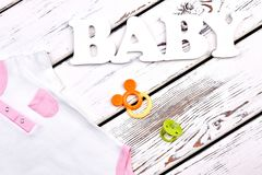 Baby-girl summer bodysuit with pocket. Royalty Free Stock Image
