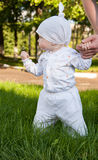 Baby girl in a summer park Stock Photo