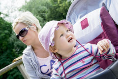 Baby girl in the sun hat with her young mother Stock Images