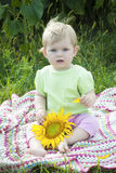 Baby girl and sunflower Royalty Free Stock Images