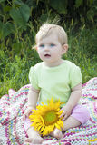 Baby girl and sunflower Stock Image