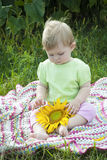 Baby girl and sunflower Royalty Free Stock Photo
