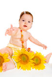 Baby girl with sunflowers Royalty Free Stock Images