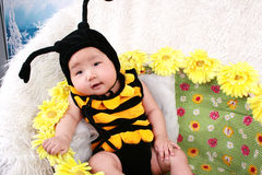 Baby girl in sunflowers Stock Photo