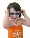 Baby girl with sunglasses. Portrait of a little girl wearing blue sun glasses Stock Photography