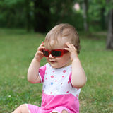 Baby girl with sunglasses Stock Image