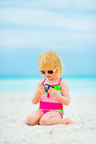 Baby girl in sunglasses with photo camera Royalty Free Stock Photos